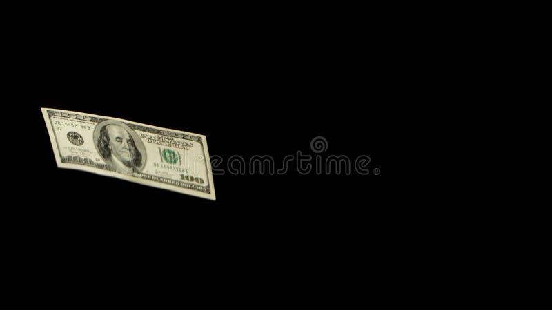 Fliegende Dollar lokalisiert auf schwarzer Hintergrundnahaufnahme lizenzfreies stockfoto