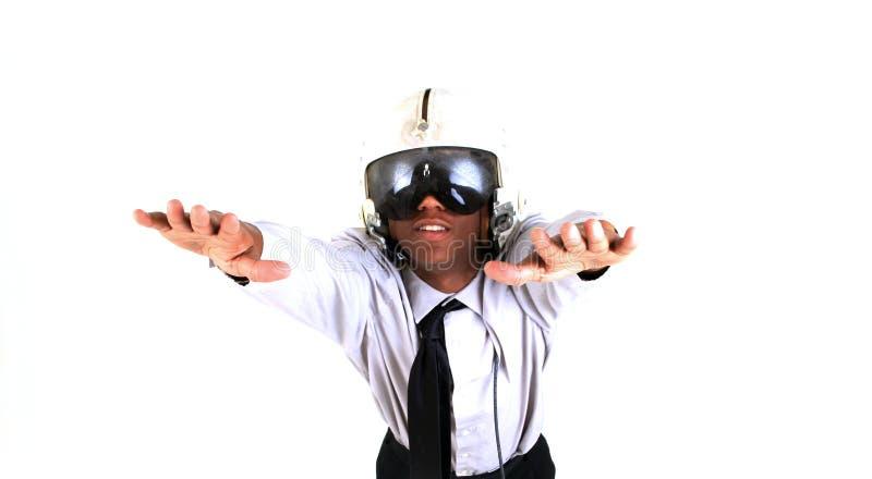 Flier. Man in flight helmet daydreaming royalty free stock photo
