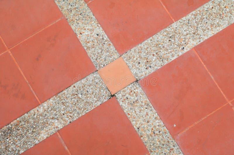 Fliesenboden-Beschaffenheitssandstein- oder Steinwäschehintergrund stockbild
