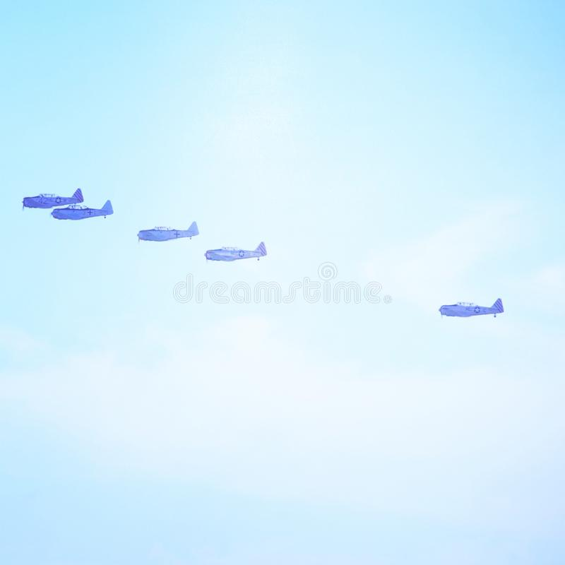 Flight of air planes over the ocean royalty free stock photography