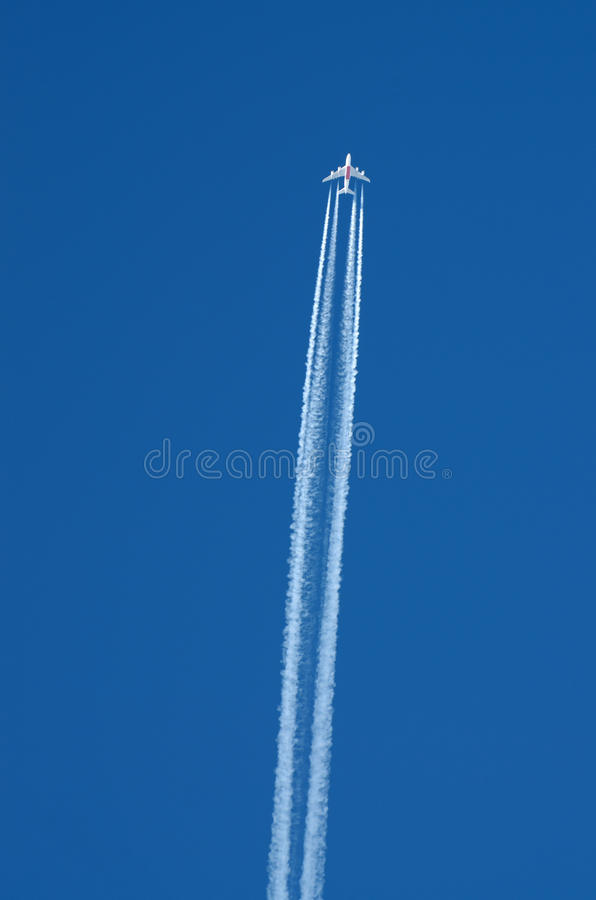 The flight of the aircraft in the sky. The aircraft is in high speed flying in the sky,leaving a trail royalty free stock images