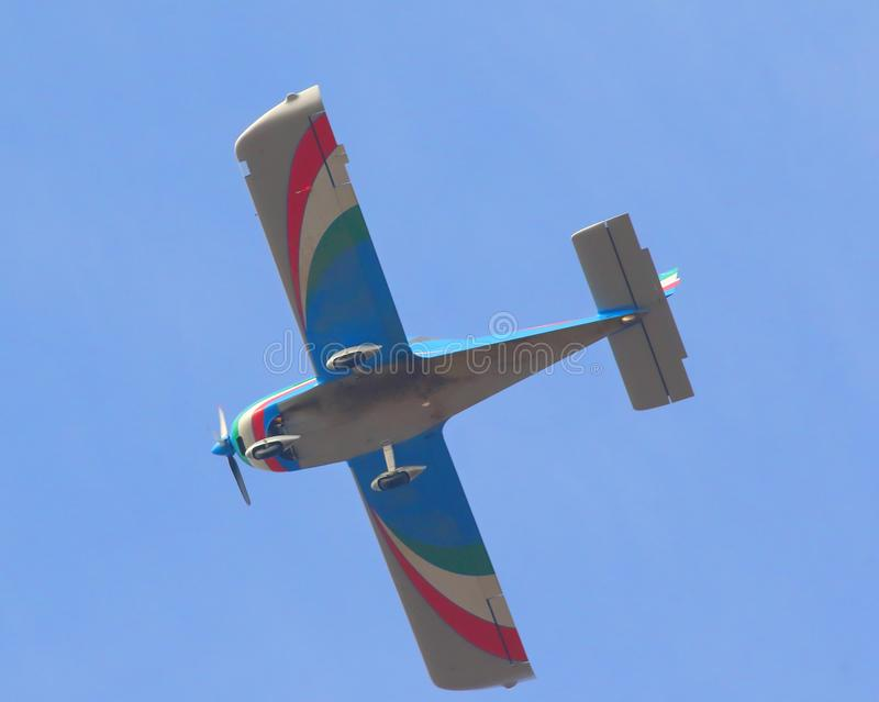 The flight of an airplane with Italian colors royalty free stock photos