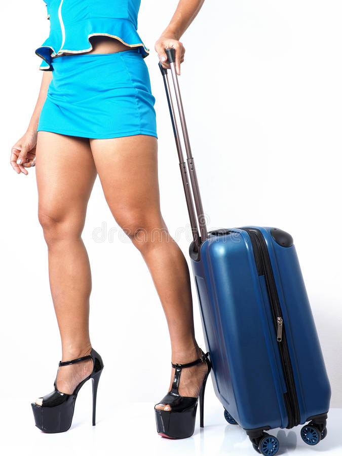Flight attendant with her carry-on royalty free stock images