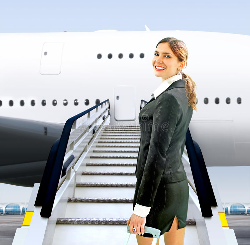 Flight attendant near moving ramp. Beautiful flight attendant near moving ramp in airport royalty free stock image