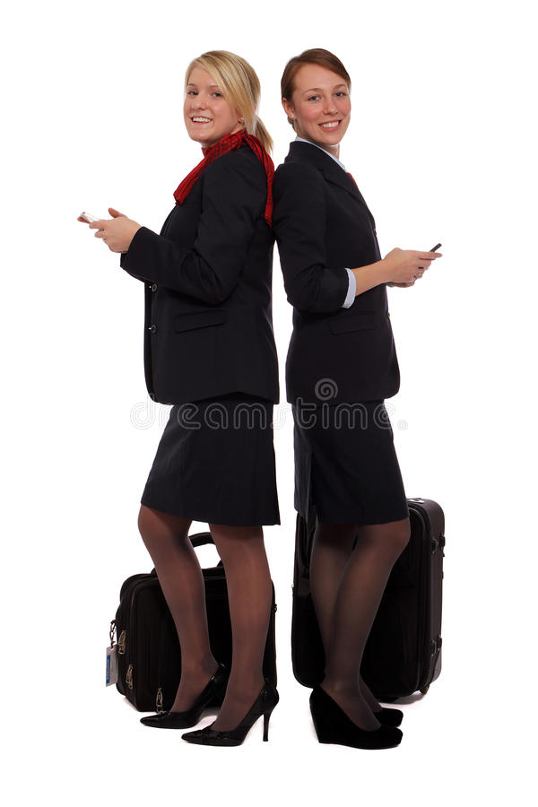 Flight attendants checking their email stock image