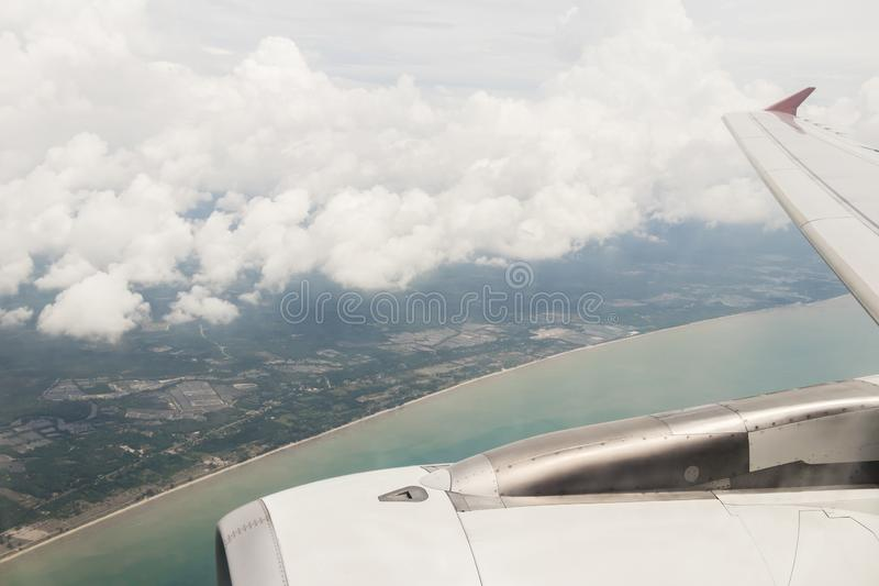Flight over Surat Thani. Blue water in Thailand with clouds stock photo