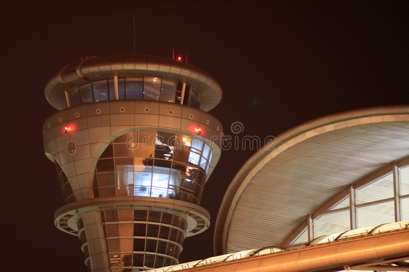 Flight control tower. It's air traffic control tower at a civil airport, pilots flight safety depend on it royalty free stock photos