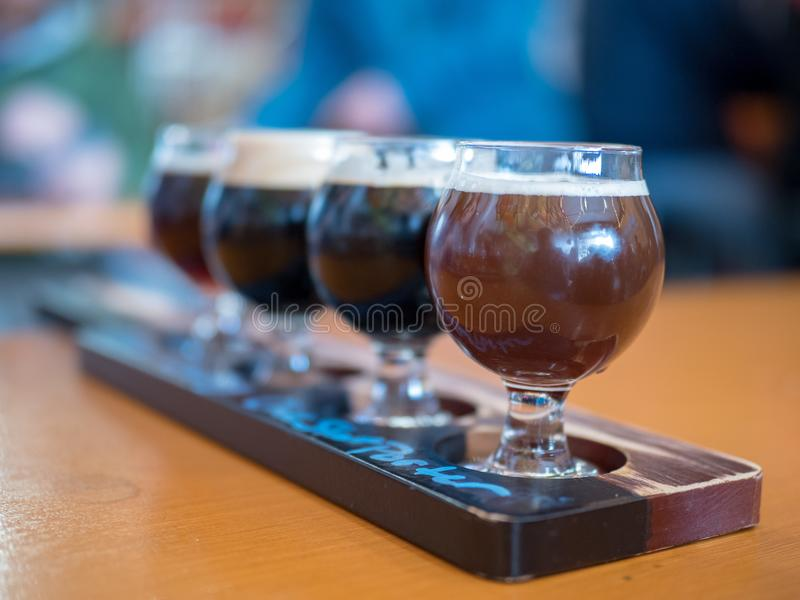 Flight of dark beers at a brewery stock image