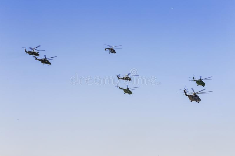The flight of a group of military helicopters holding.`Helicopters of Russia`. MAKS 2019 in Zhukovsky. royalty free stock image
