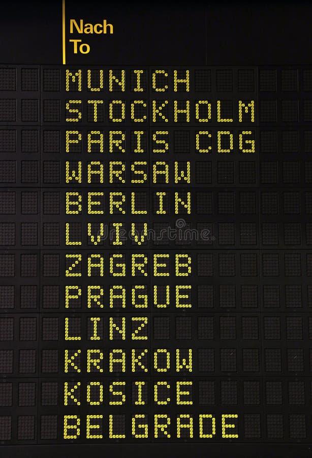 Flight information panel at airport stock photo