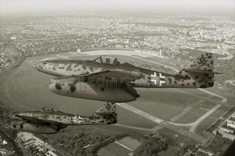 In flight Me 262. Two Me 262 flying over the historic old main airport Tempelhof in Berlin Germany. Image has bin reworked in Black and white look stock photos