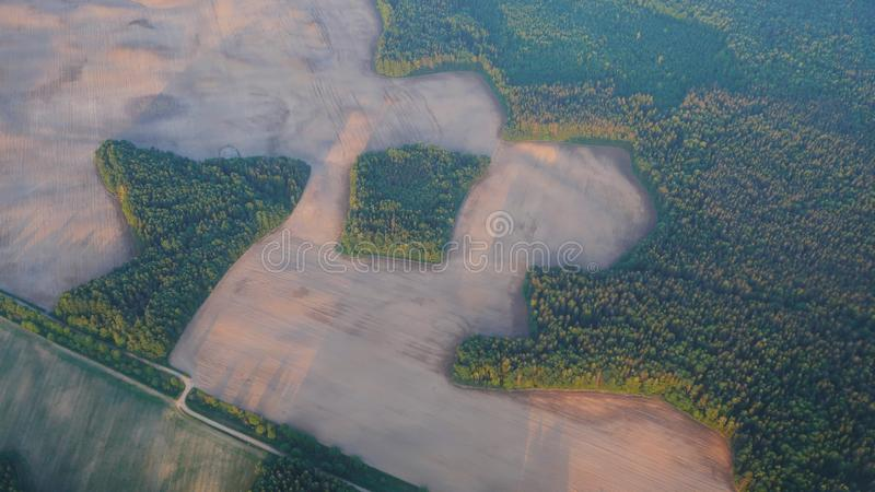 Flight over the Russian fields and water purification station. stock photos