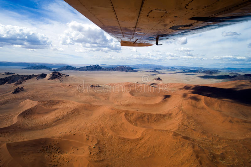 Sossusvlei orange dunes seen from plane, aerial view royalty free stock photo