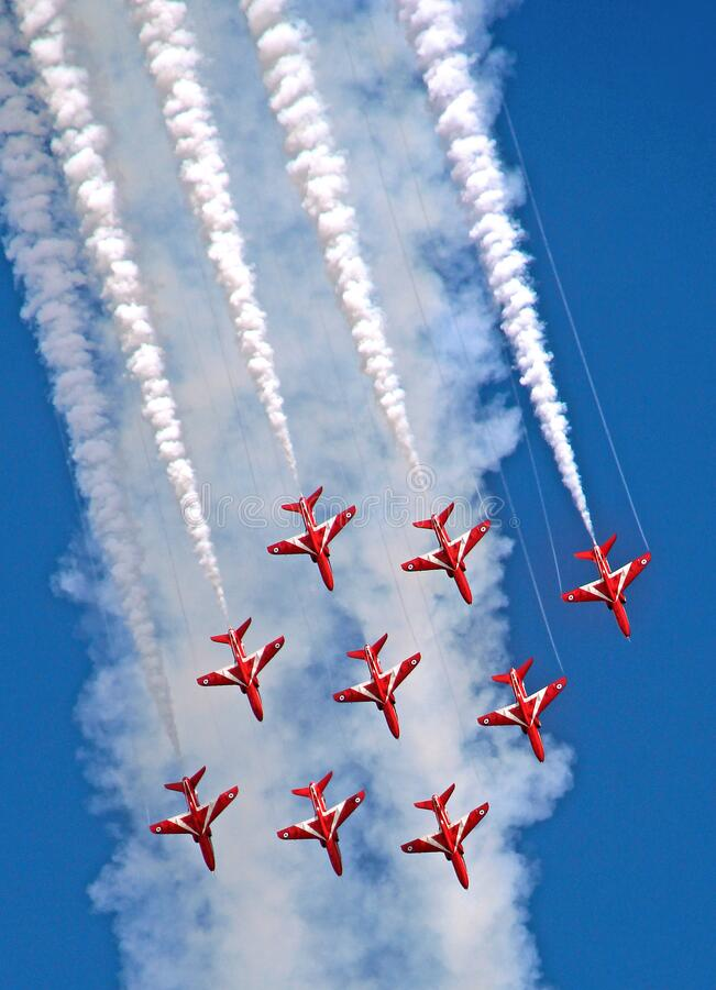 Flight of the red arrows royal air force aerobatic display team aeroplanes planes jets sky hawk airshow aircraft stock photos