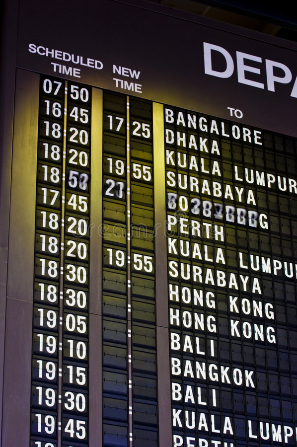 Flight Schedules. Flight schedule board at the airport showing countries and rescheduled timings royalty free stock photography