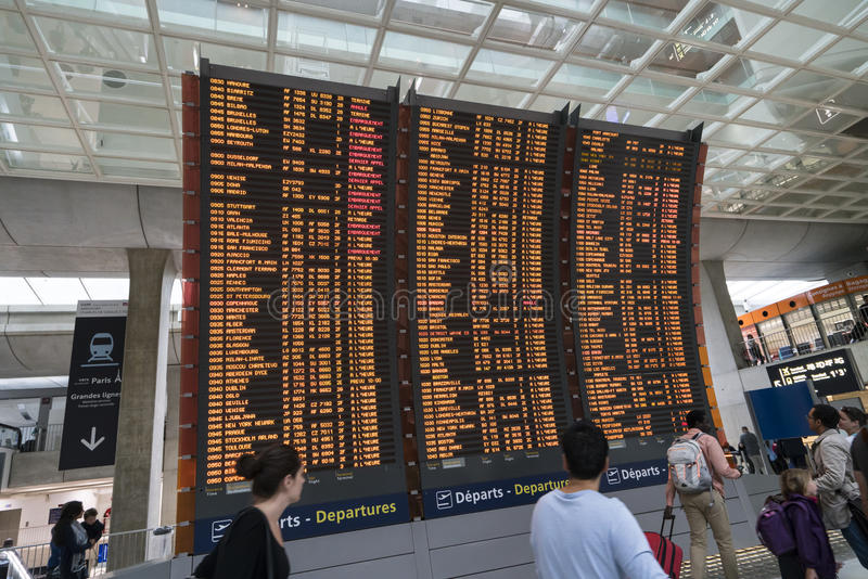 Flight timetable at the airport. Screens with flight schedules at the Charles de Gaulle airport in Paris stock photos