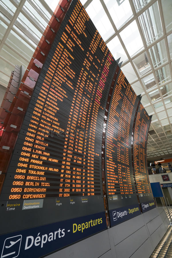 Flight timetable at the airport. Screens with flight schedules at the Charles de Gaulle airport in Paris stock photo