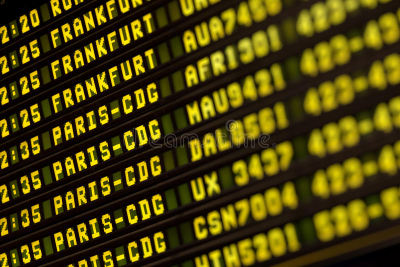 Flights information board in airport terminal stock images