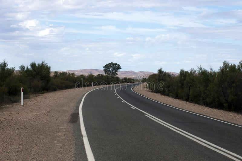 Flinders` Ranges Way leading away from Hawker to Wilpena Pound, SA, Australia. Bitumen Flinders` Ranges Way leading away from Hawker to Wilpena Pound, South royalty free stock photography