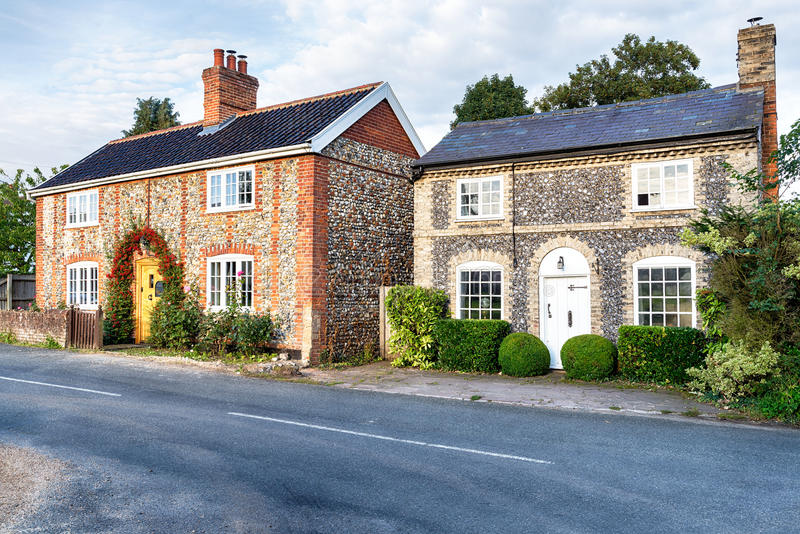 Flint Cottages in Norfolk. Pretty country cottages made from brick and flint in Norfolk royalty free stock image