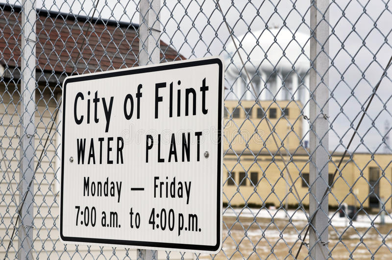 Flint, Michigan: City of Flint Water Plant Sign. FLINT, MICHIGAN-January 23, 2016:City of Flint Water Plant Sign on chain link fence in Downtown Flint, Michigan stock photography