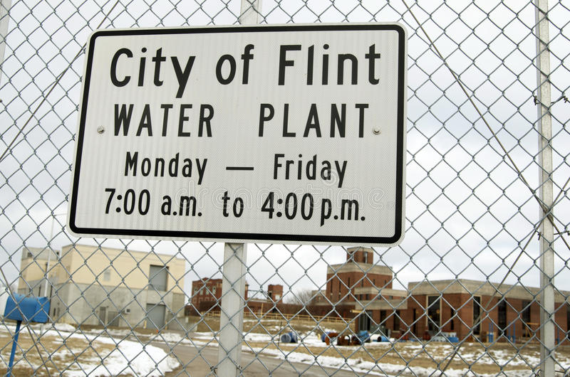 Flint, Michigan: City of Flint Water Plant Sign. FLINT, MICHIGAN-January 23, 2016:City of Flint Water Plant Sign on chain link fence in Downtown Flint, Michigan royalty free stock images