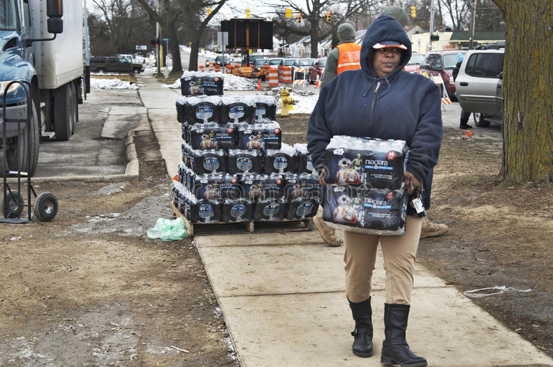 Flint, Michigan: Emergency Water Distribution. FLINT, MICHIGAN-January 23, 2016:Flint bottled water distribution by National Guardsmen in Downtown Flint stock photography
