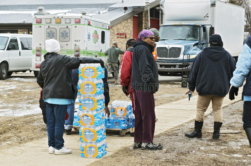 Flint, Michigan: Emergency Water Distribution. FLINT, MICHIGAN-January 23, 2016:Flint bottled water distribution by National Guardsmen in Downtown Flint stock photo