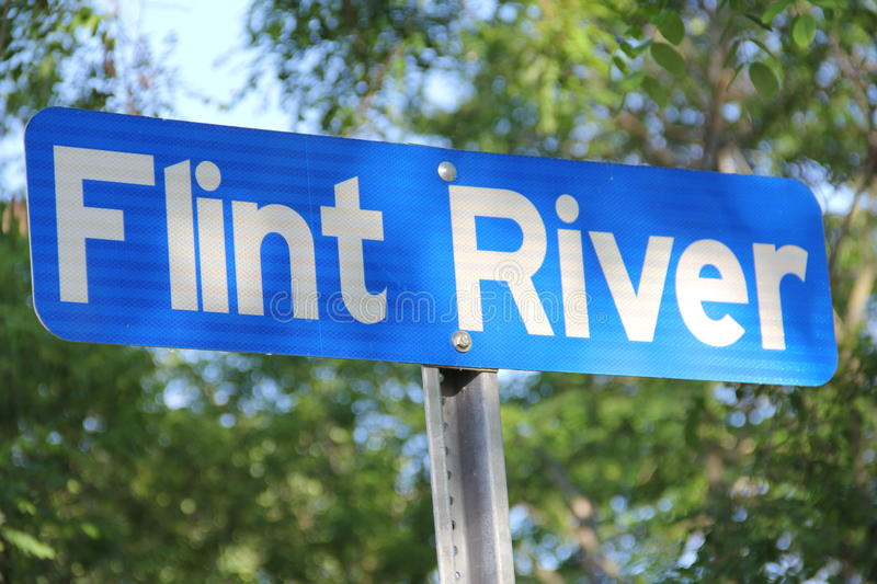 The Flint River. A blue sign for the Flint River royalty free stock photo