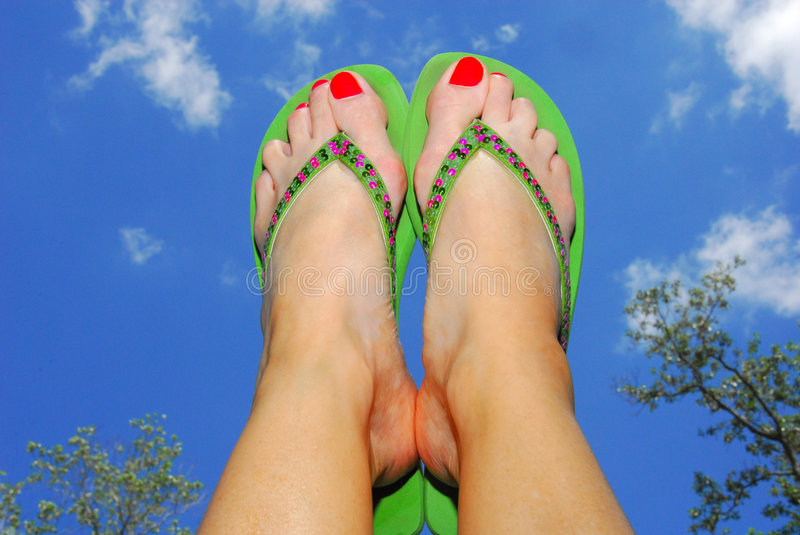 Flip Flop and Feet in Air royalty free stock images