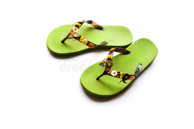 Flip flops. Green flip flops with beaded decoration royalty free stock photography