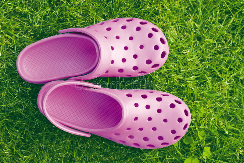 Flip-flops. Pink flip-flops on the grass royalty free stock photography