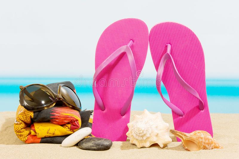 Flip flops on the beach. And sea royalty free stock photos