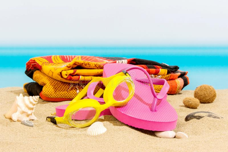 Flip flops on the beach. And sea royalty free stock photo