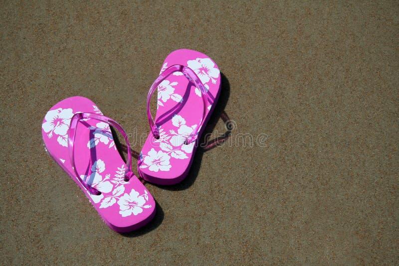 Flip-flops on the beach stock image