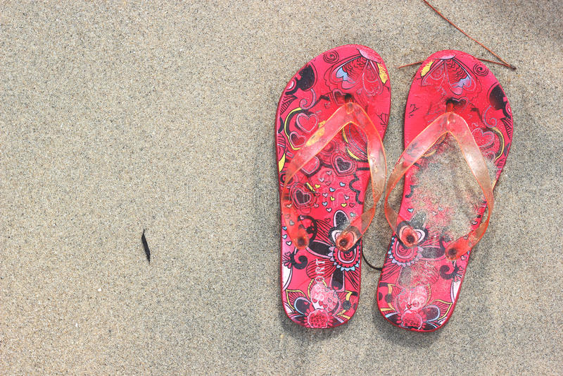 Flip Flops on the beach sand texture background royalty free stock photos