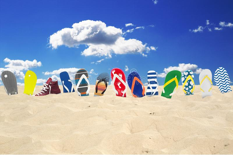 Flip-flops on the beach. Summer holidays at the sea royalty free stock images