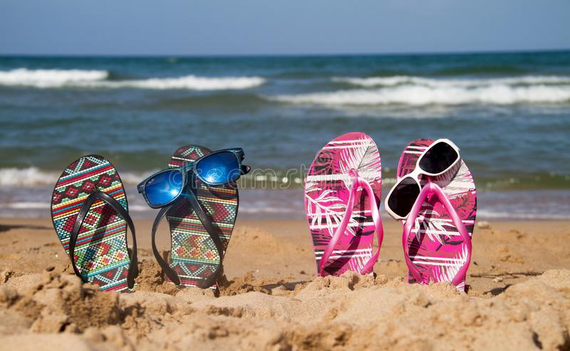 Flip flops on the beach royalty free stock images