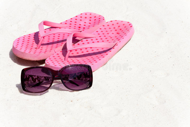 Flip-Flops on the Beach. Flip-Flops and Sunglasses in the Sand on the Beach stock image