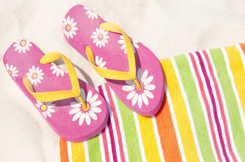 Flip flops on beach towel stock photography