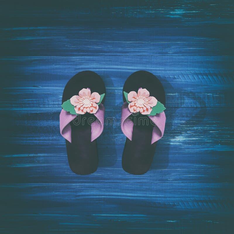 Flip flops on a blue background. Flip flops on a blue wooden background stock photos