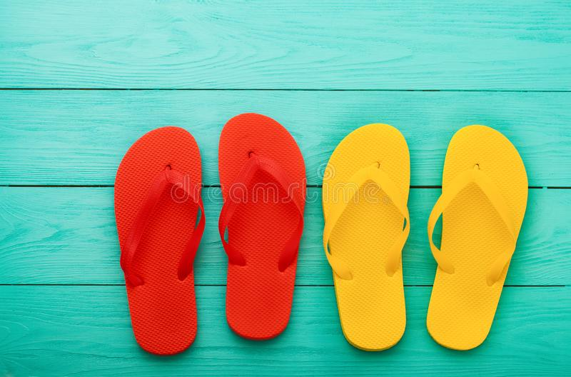 Flip flops on blue wooden background with copy space. Top view. Mock up. Summer shoes sandals. Slippers royalty free stock photo
