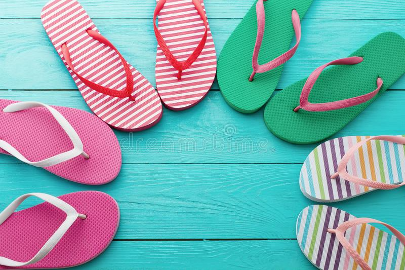 Flip flops on blue wooden floor background. Top view and copy space. Summer fun holidays. Beach Sandals stock images