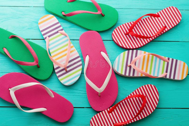 Flip flops on blue wooden floor background. Top view and copy space. Summer fun weekend royalty free stock photo
