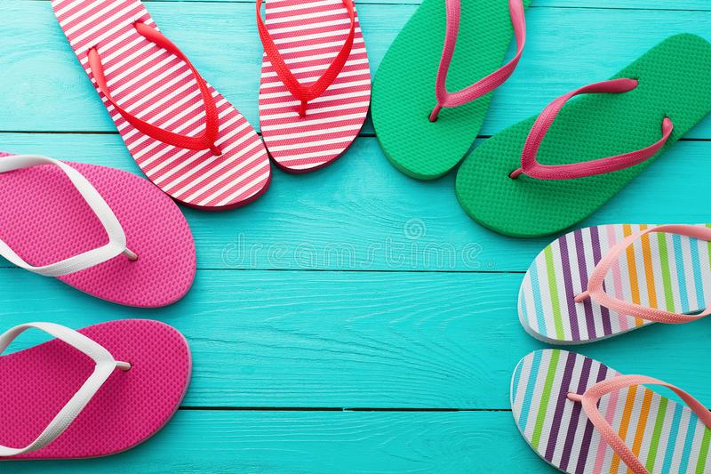 Flip flops on blue wooden floor background. Top view and copy space. Summer fun weekend royalty free stock photography