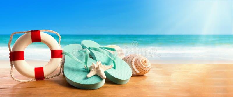 Flip flops with buoy on the beach. Flip flops with buoy on the tropical beach stock images