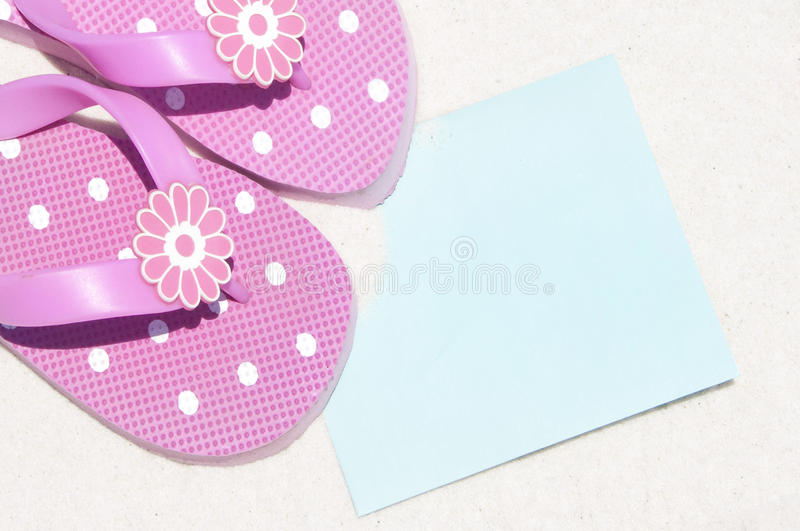 Flip flops by card royalty free stock image