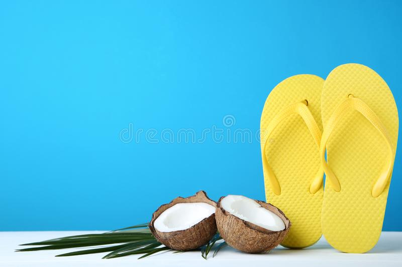 Flip flops with coconut royalty free stock image