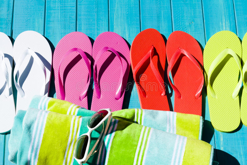 Flip flops. Colorful flip flops by a swimming pool royalty free stock photos