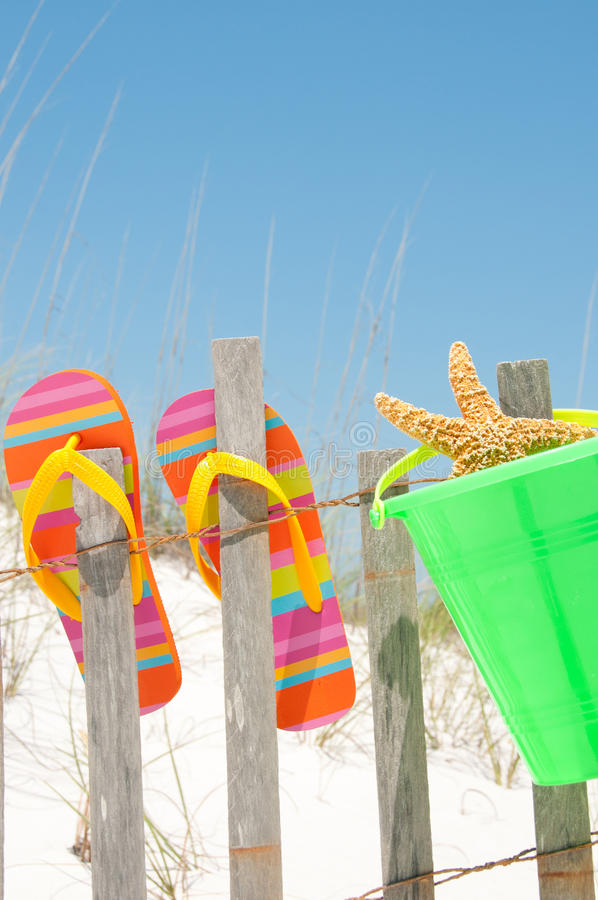 Flip flops on fence. Flip flops hanging on fence royalty free stock photos